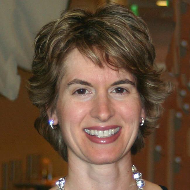 Dr. Michelle Enmark smiling whilst wearing a diamond necklace