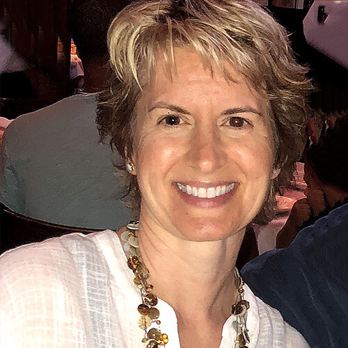 Dr. Michelle Enmark smiling in while wearing a necklace